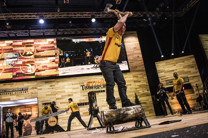 Team Romania performs during the Team Competition of the Stihl Timbersports World Championships at the Porsche-Arena in Stuttgart, Germany on November 11, 2016.